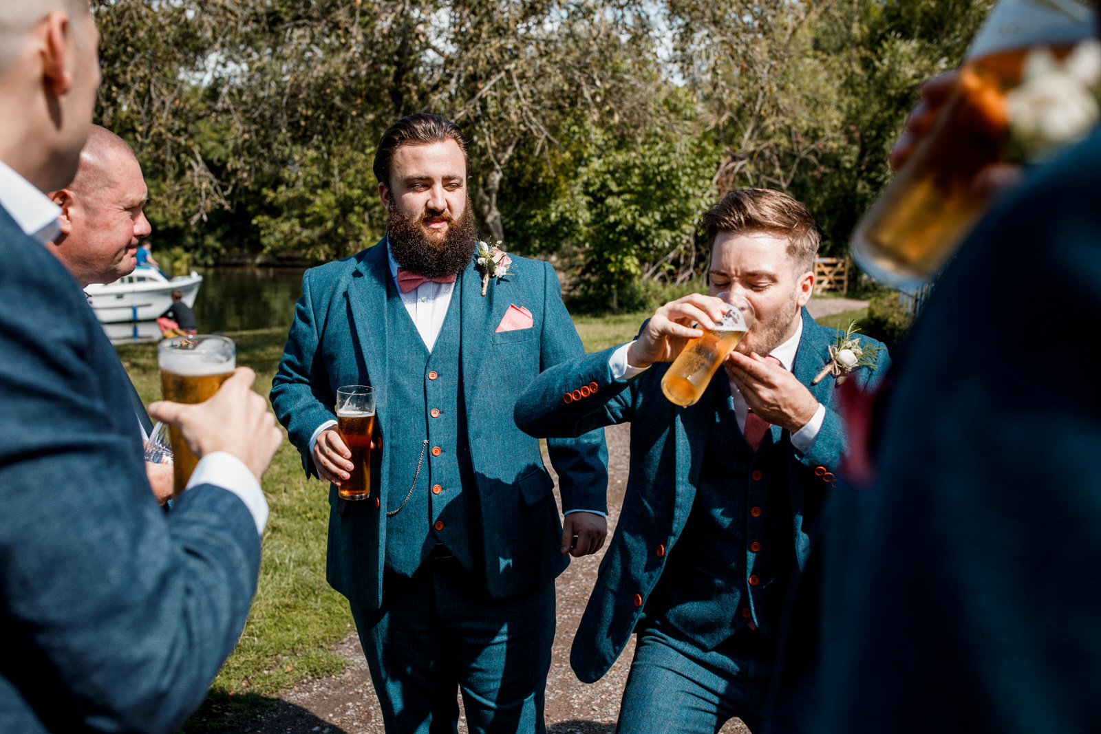 groom and best man having a beer