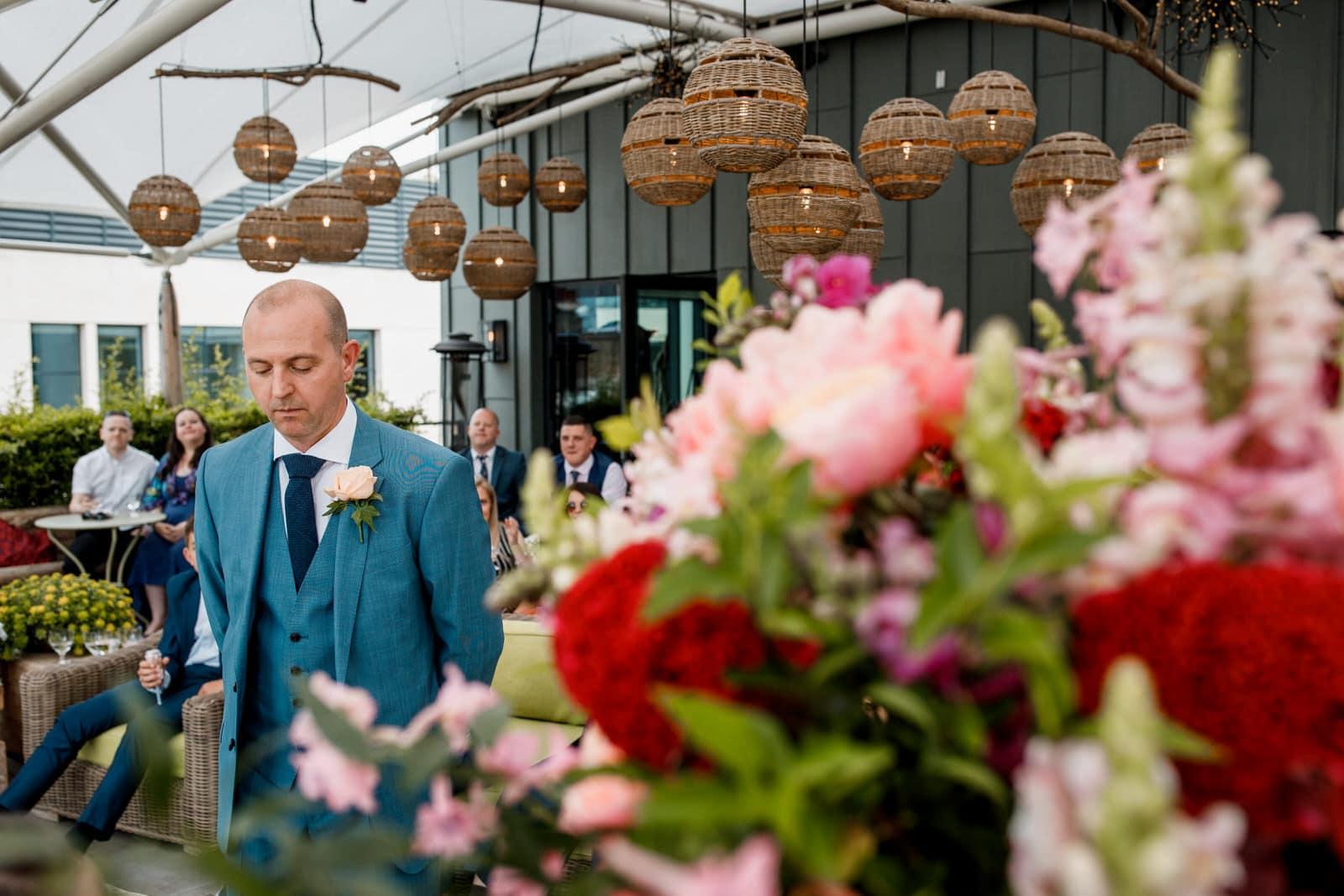 groom waiting for bride at ham yard hotel roof garden wedding