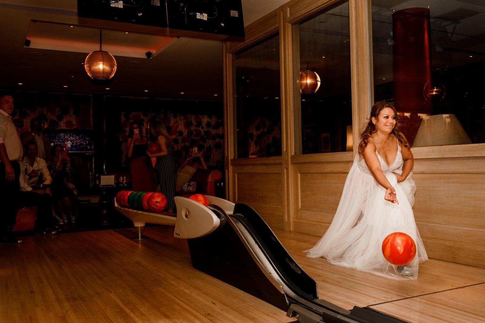 bride bowling at ham yard hotel wedding