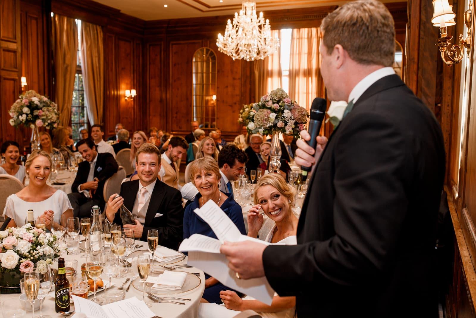 bride looking at groom during wedding speech