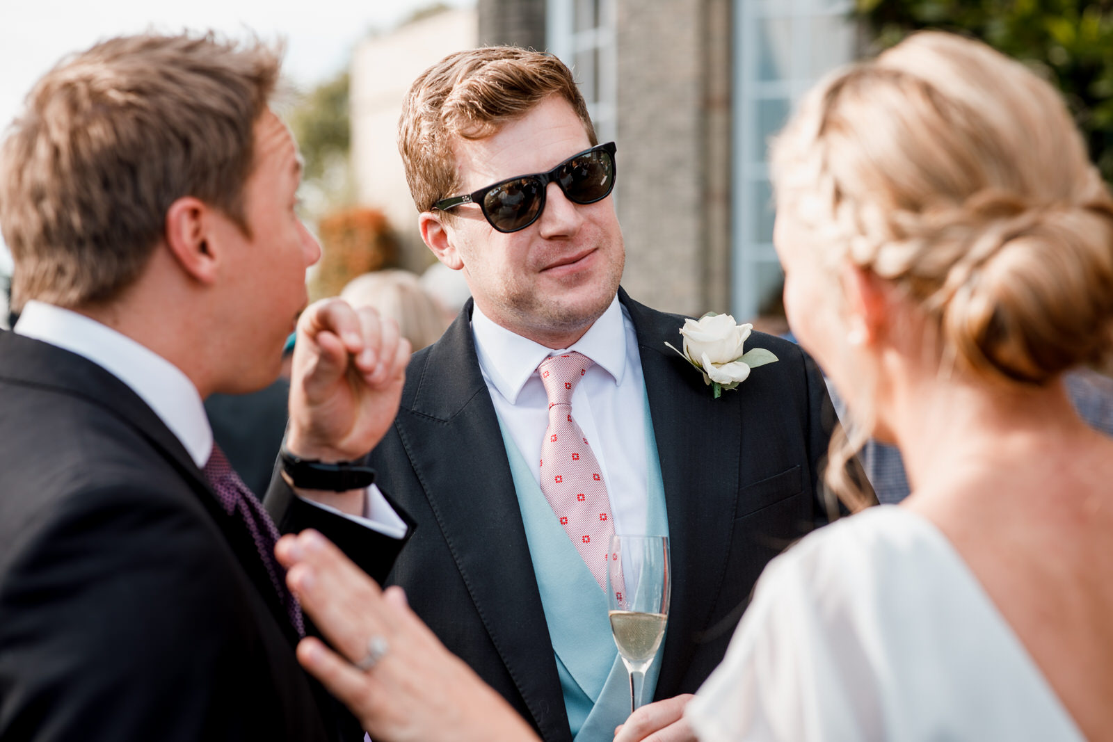 groom in sunglasses at hedsor house