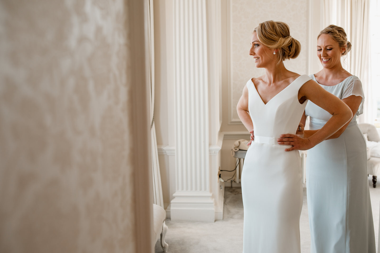 bride getting into dress at hedsor house bridal suite