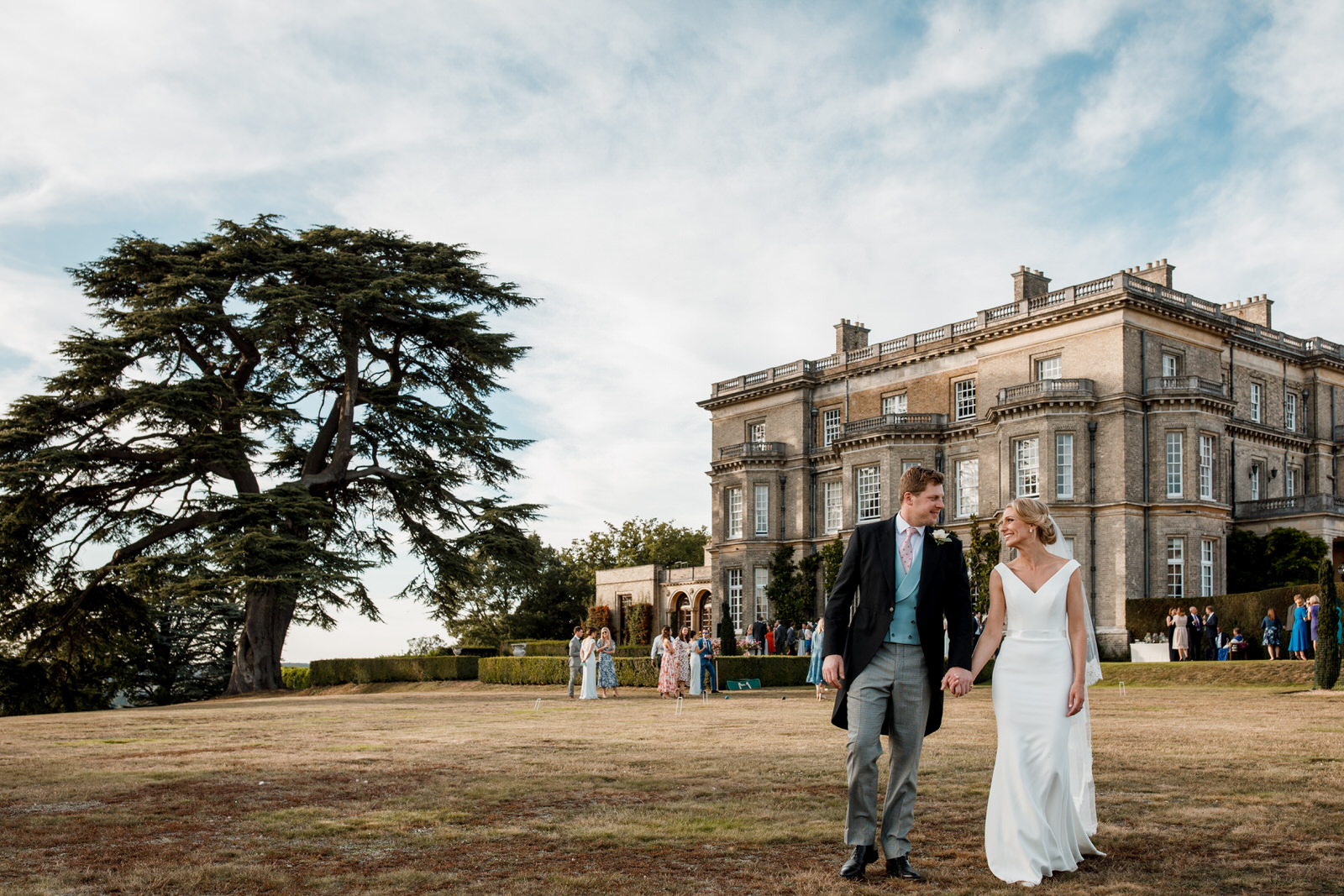 bride and groom on lawn outside hedsor house