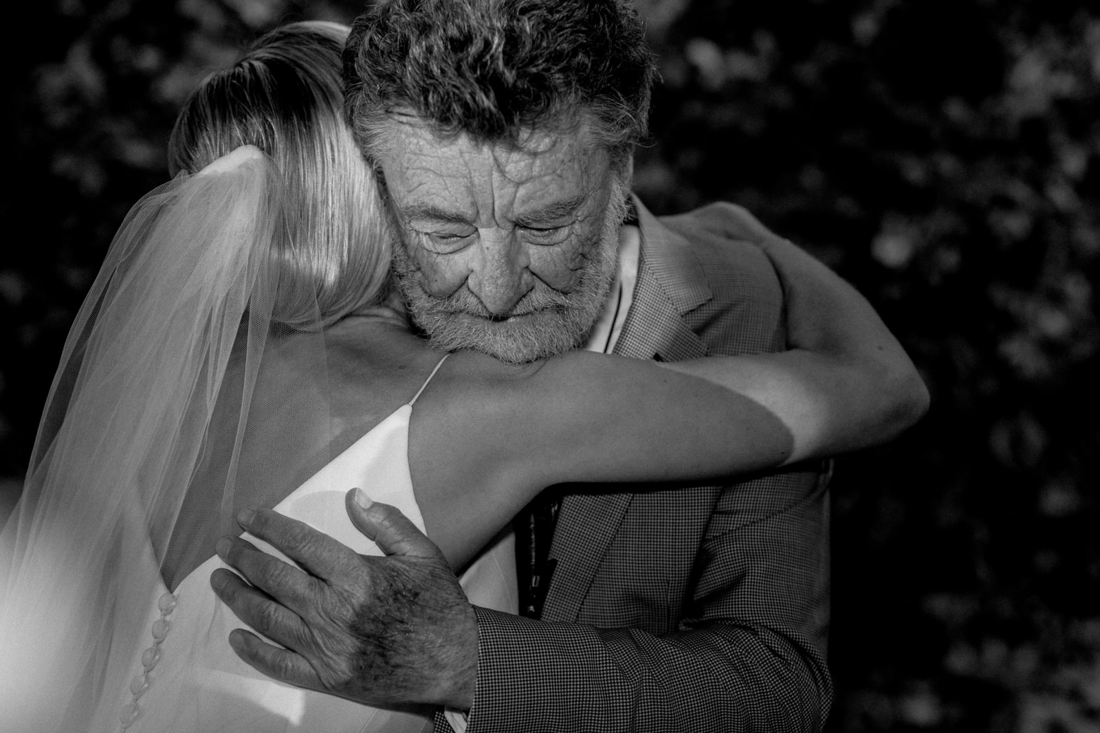 father hugging daughter on her wedding day
