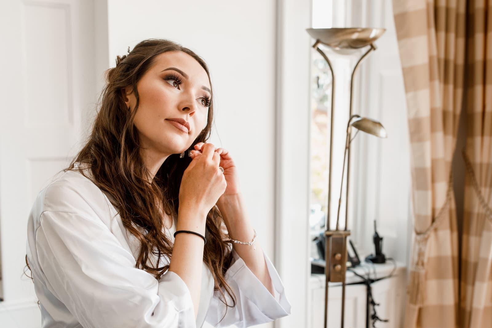 bride getting ready at west heath wedding venue