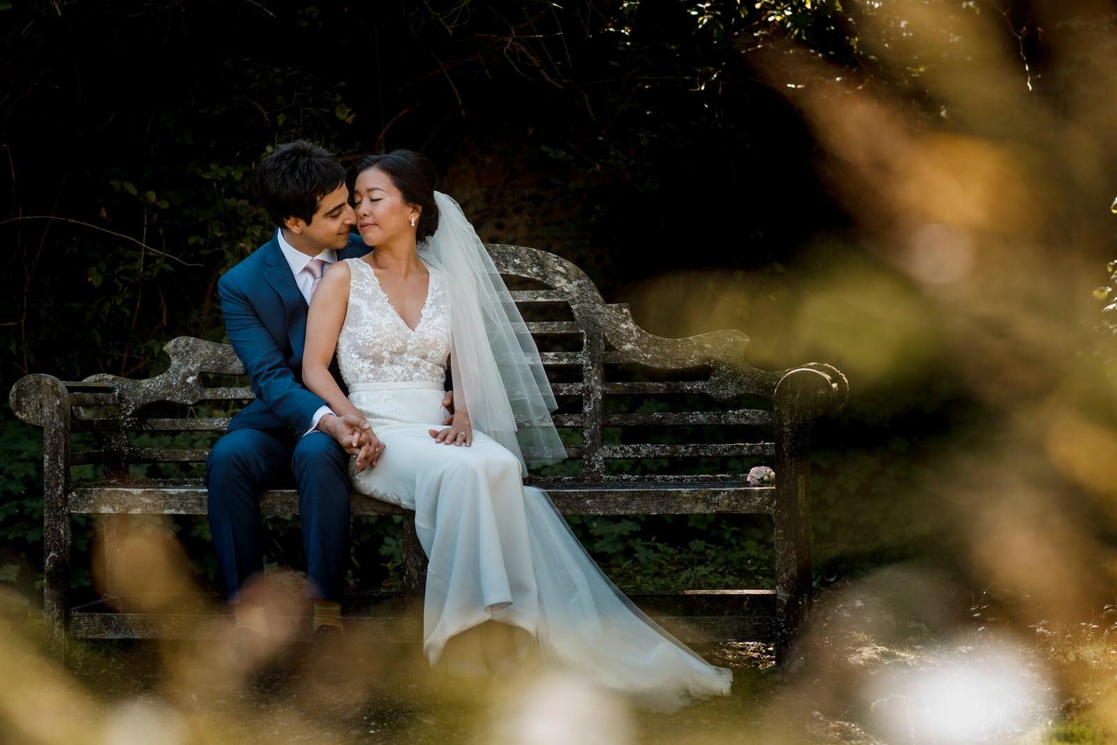 newlyweds sitting on bench