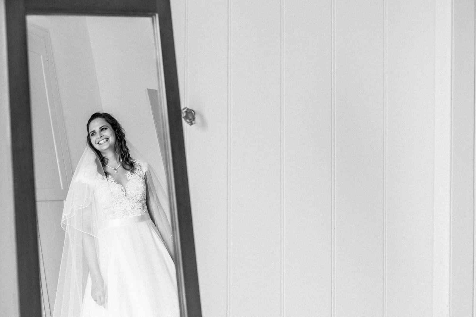 bride reflection in mirror wearing wedding dress