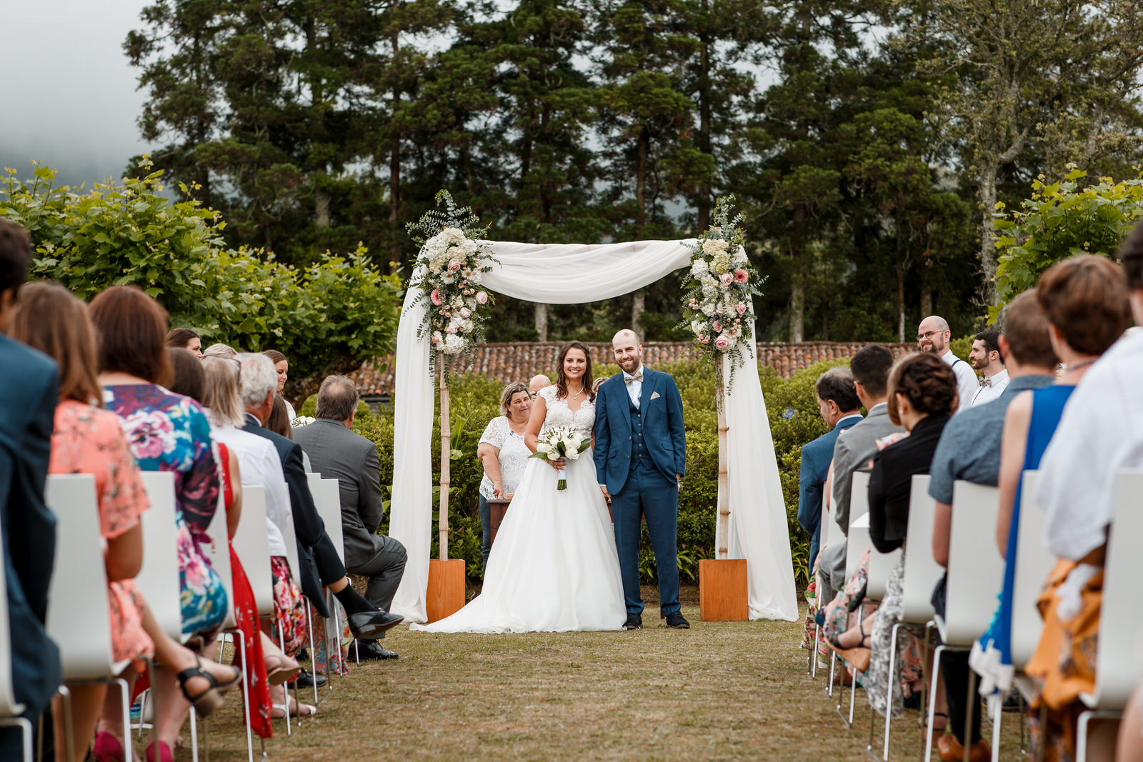 bride and groom at altar in garden wedding