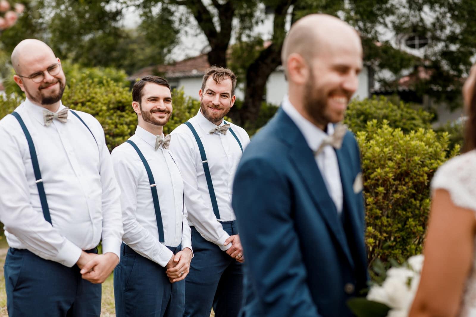 groomsmen behind groom