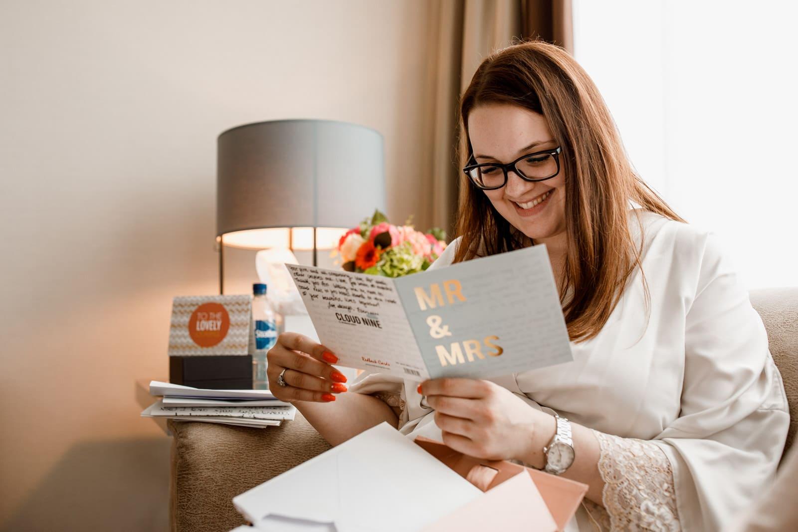 bride reading wedding card