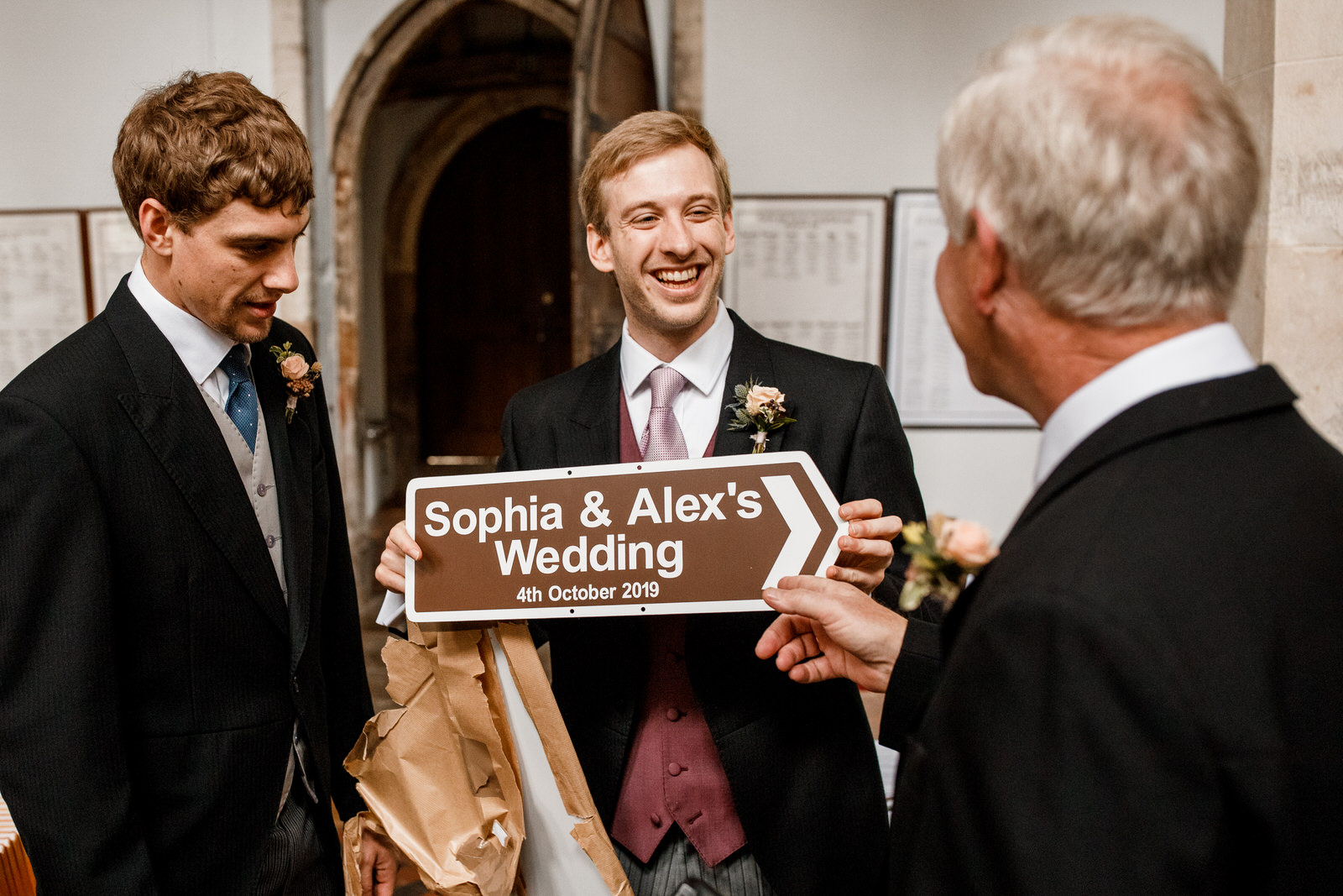 groom with wedding sign