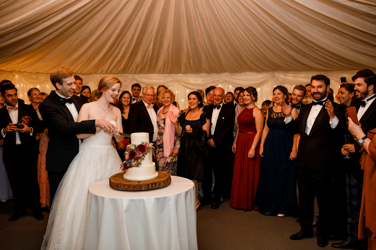 cake cutting at wedding in old luxters barn