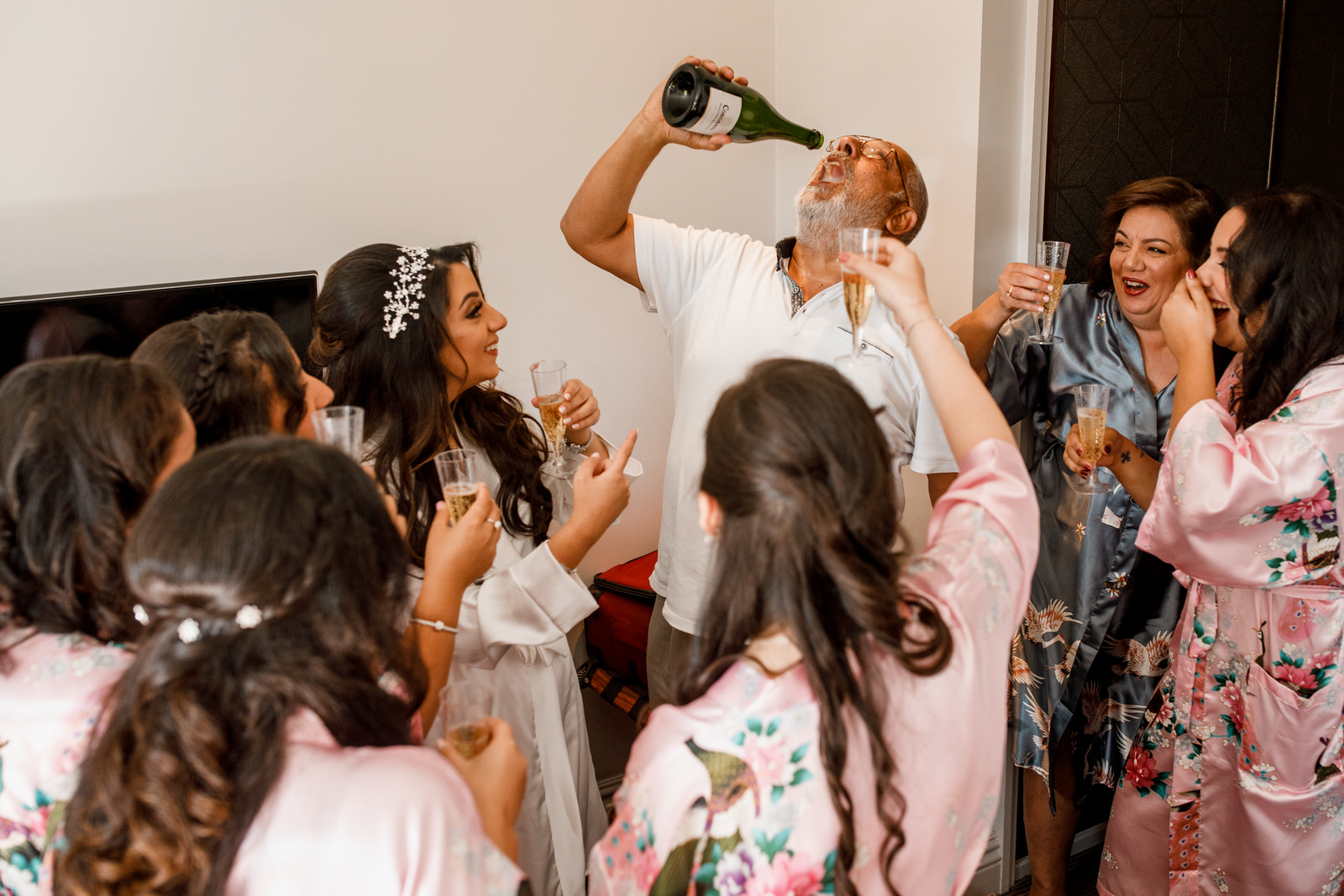 father of the bride with bridesmaids enjoying champagne