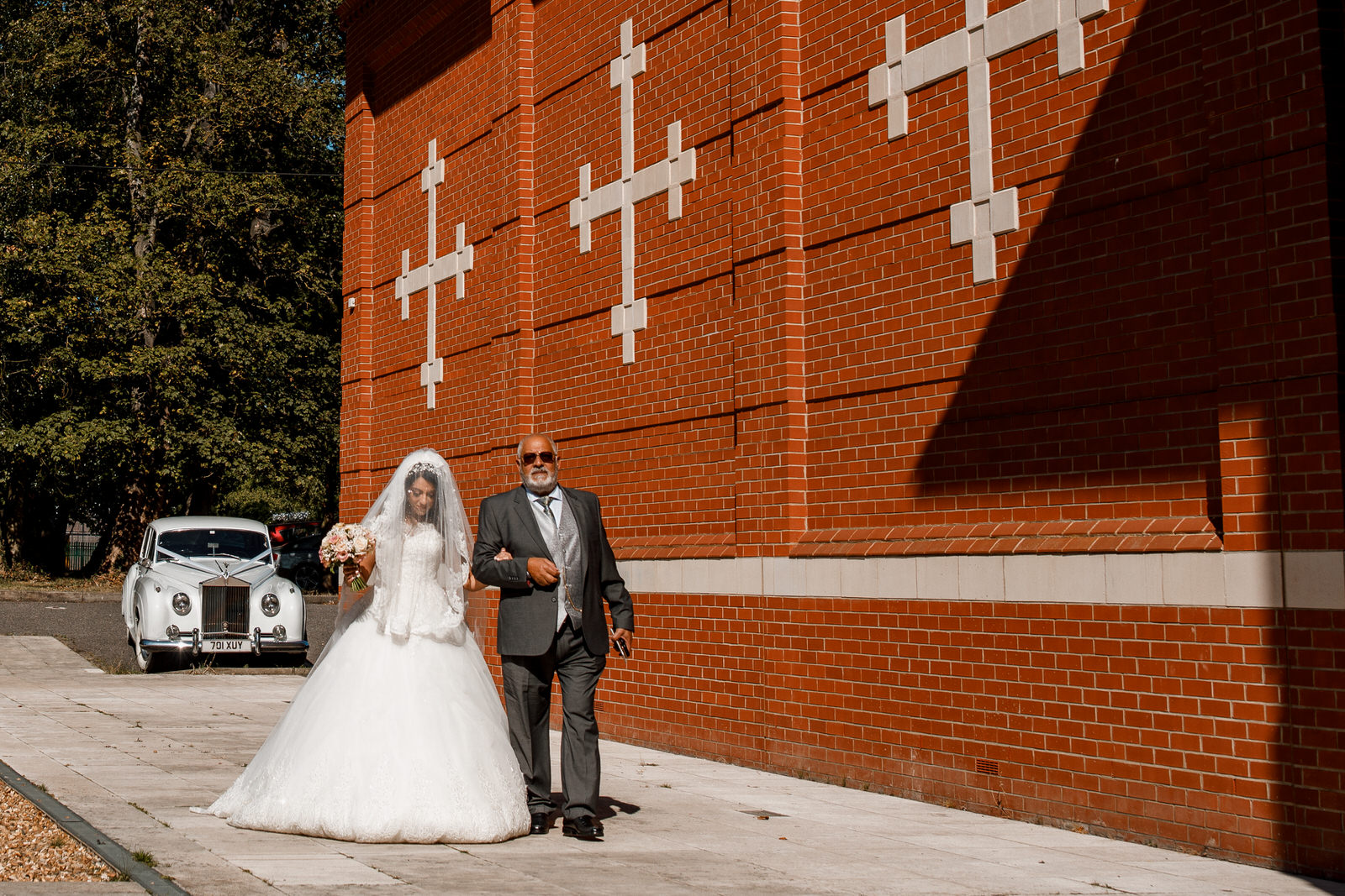bride walking with father to church