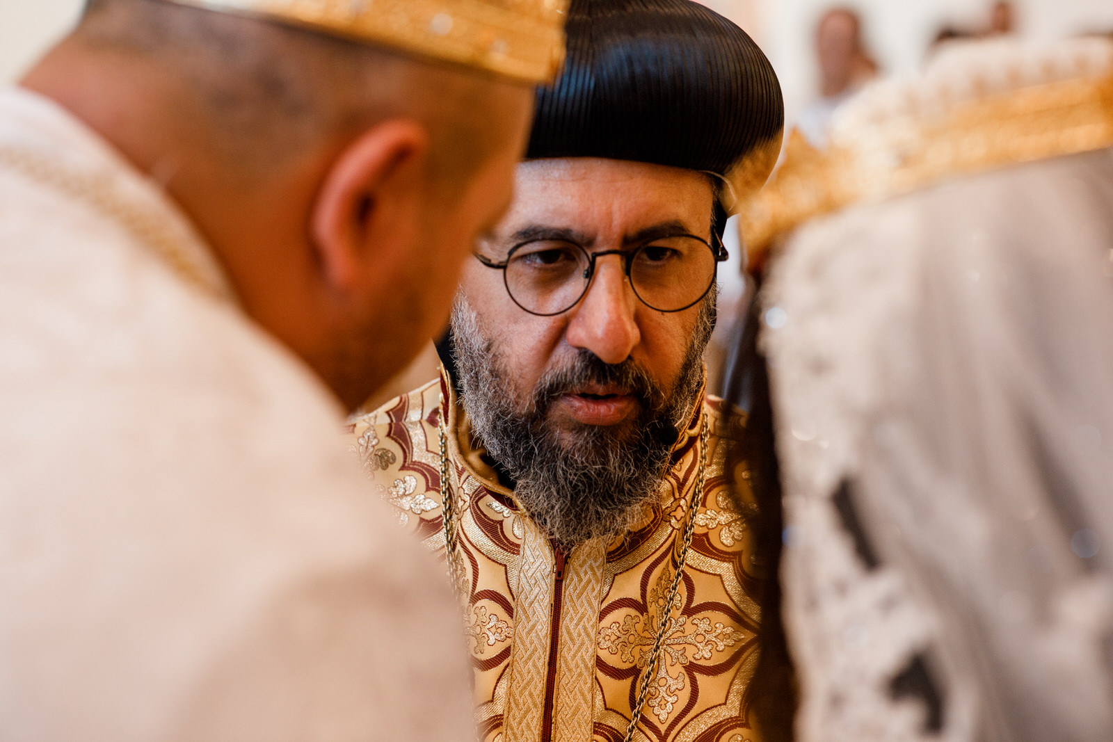 egyptian priest talking to bride and groom