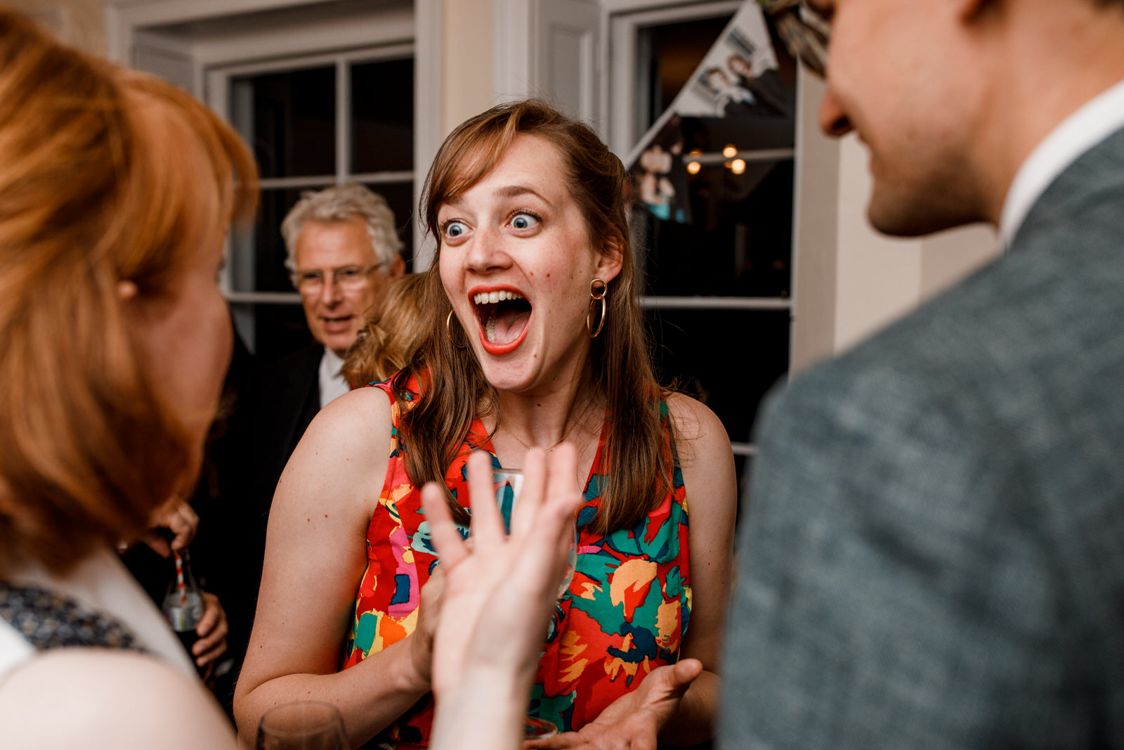 guest laughing on dancefloor of wedding