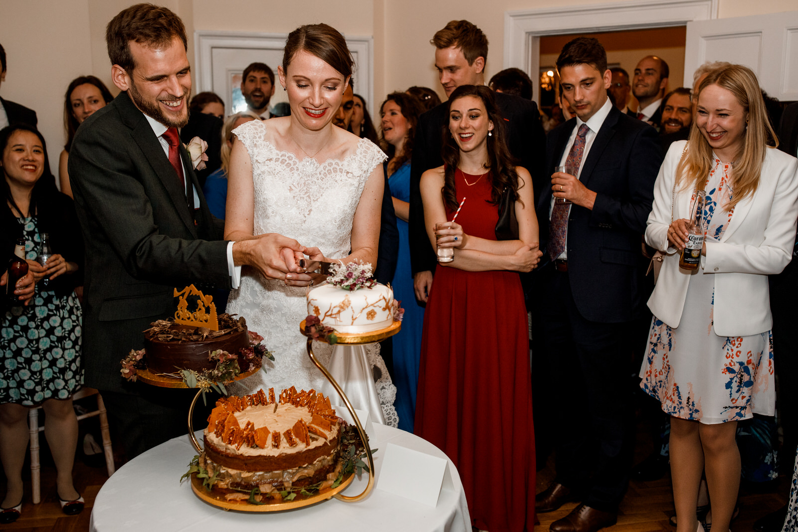 wedding cake cut at richmond park wedding