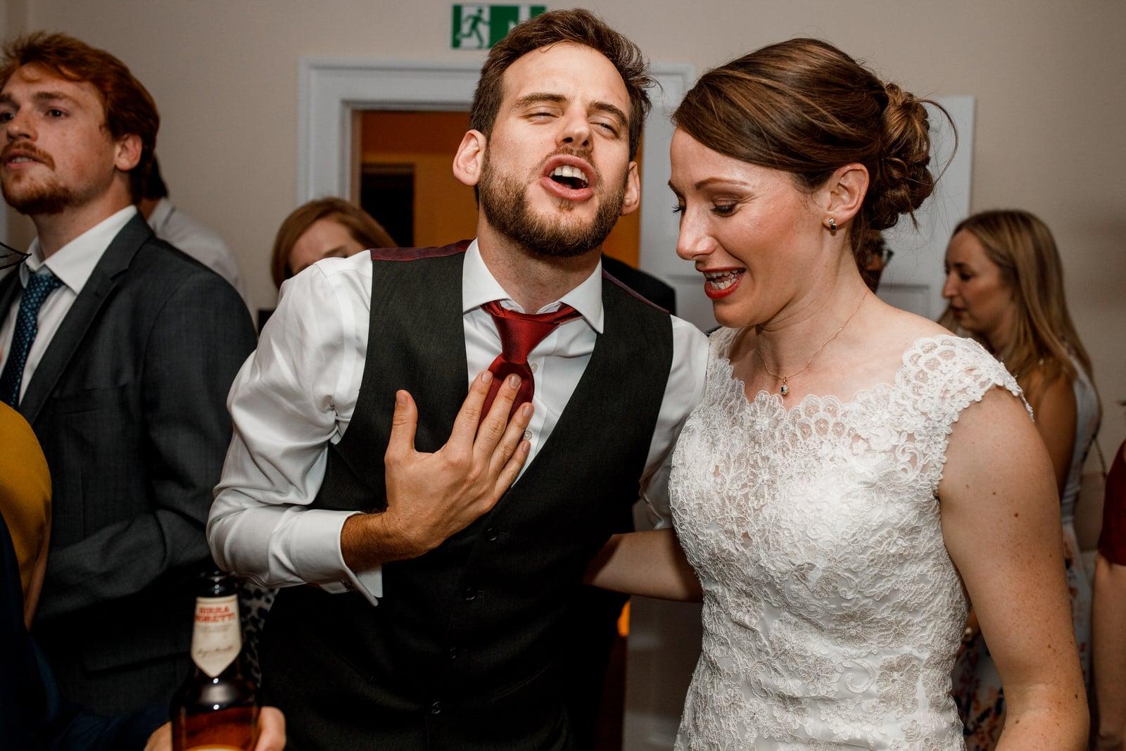 bride and groom dancing on floor at wedding