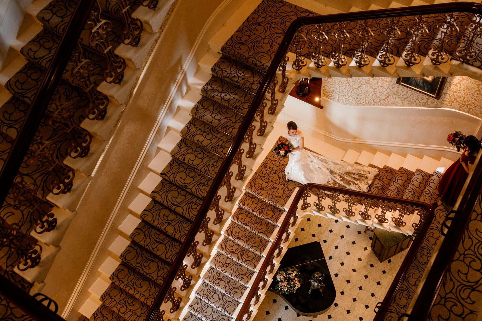 bride leaving down stairs of petersham hotel