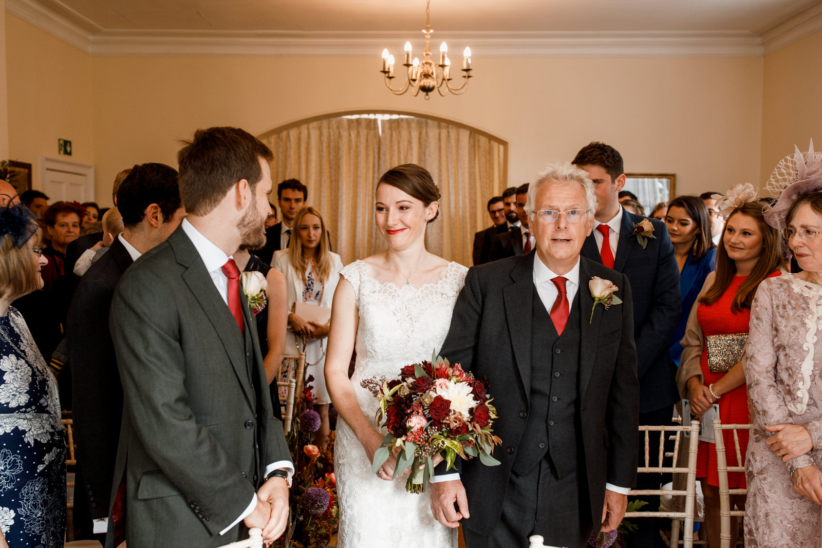 bride walking down the aisle at pembroke lodge wedding