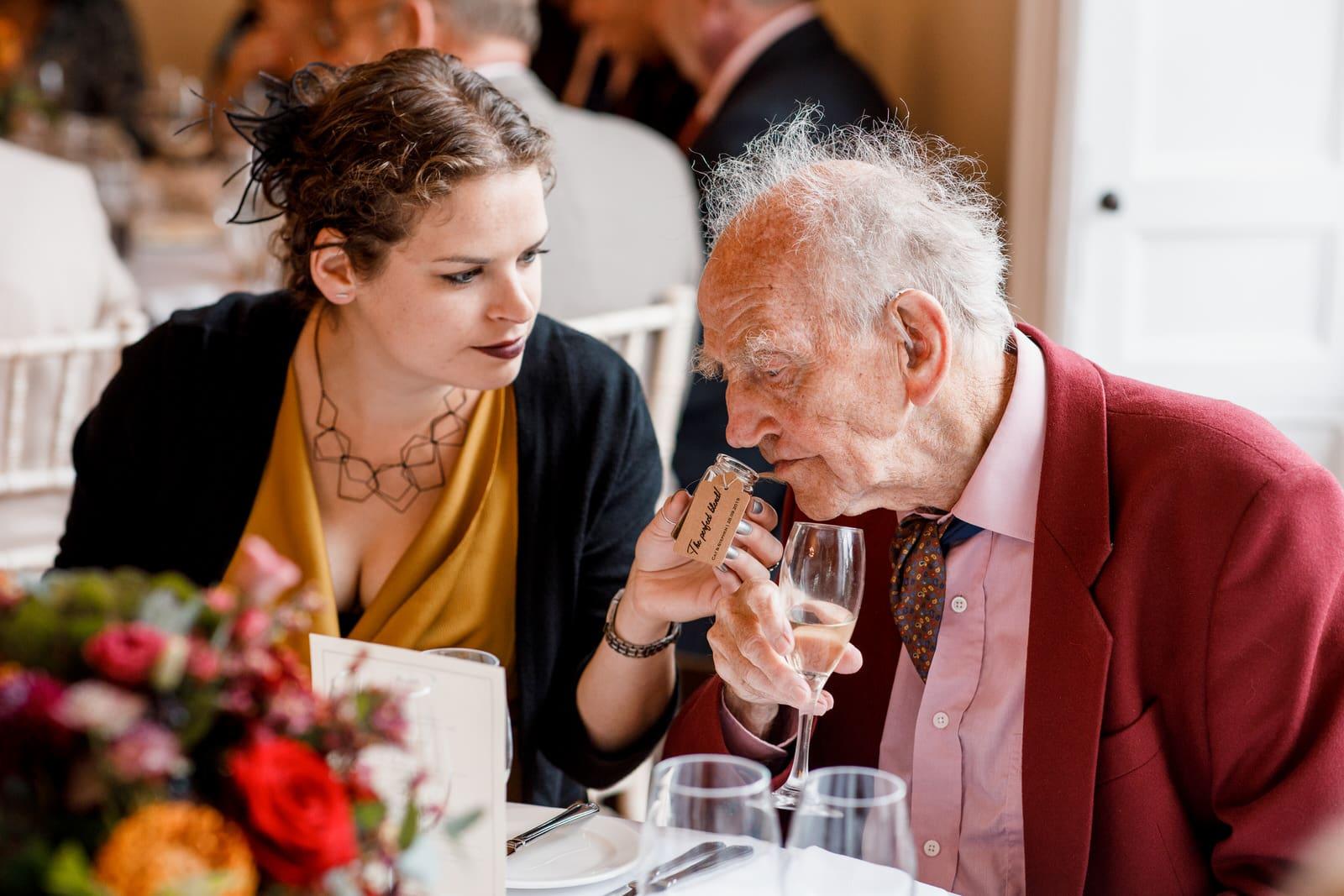 grandad smelling wedding favour