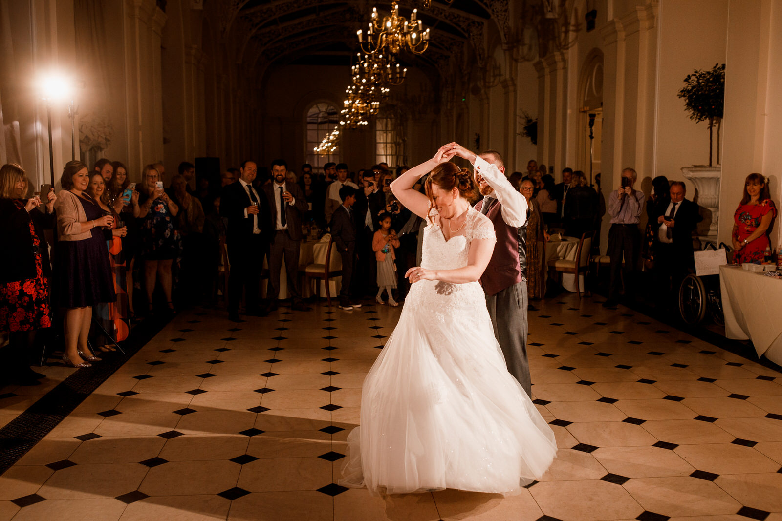 bride and groom dancing at blenheim palace wedding
