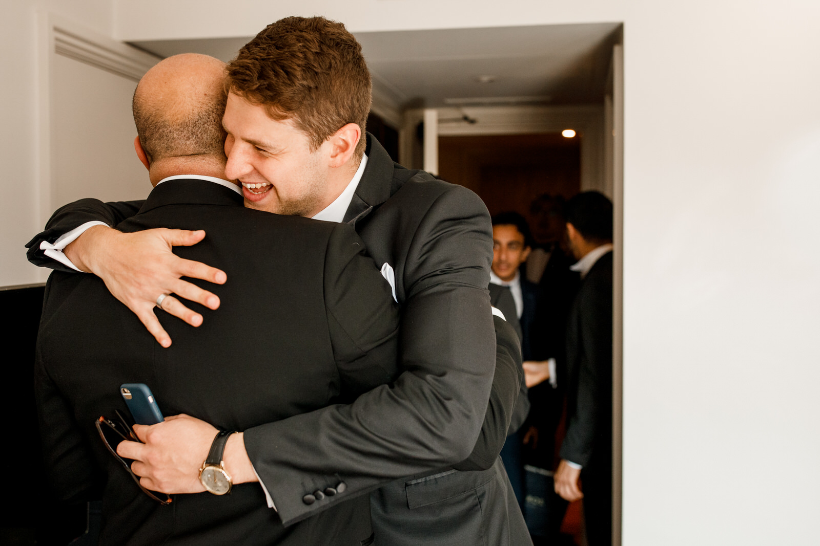groom being hugged by best man