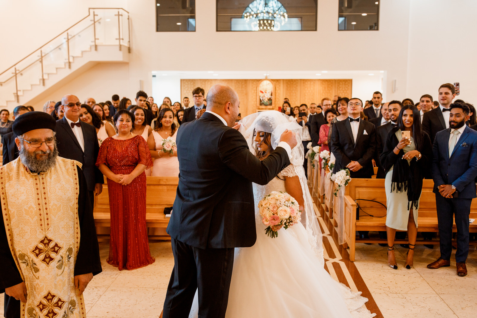 groom lifting veil of bride at wedding