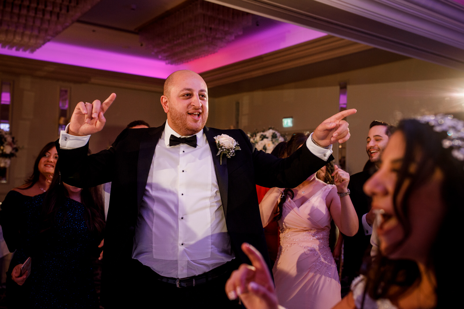 groom dancing at egyptian wedding