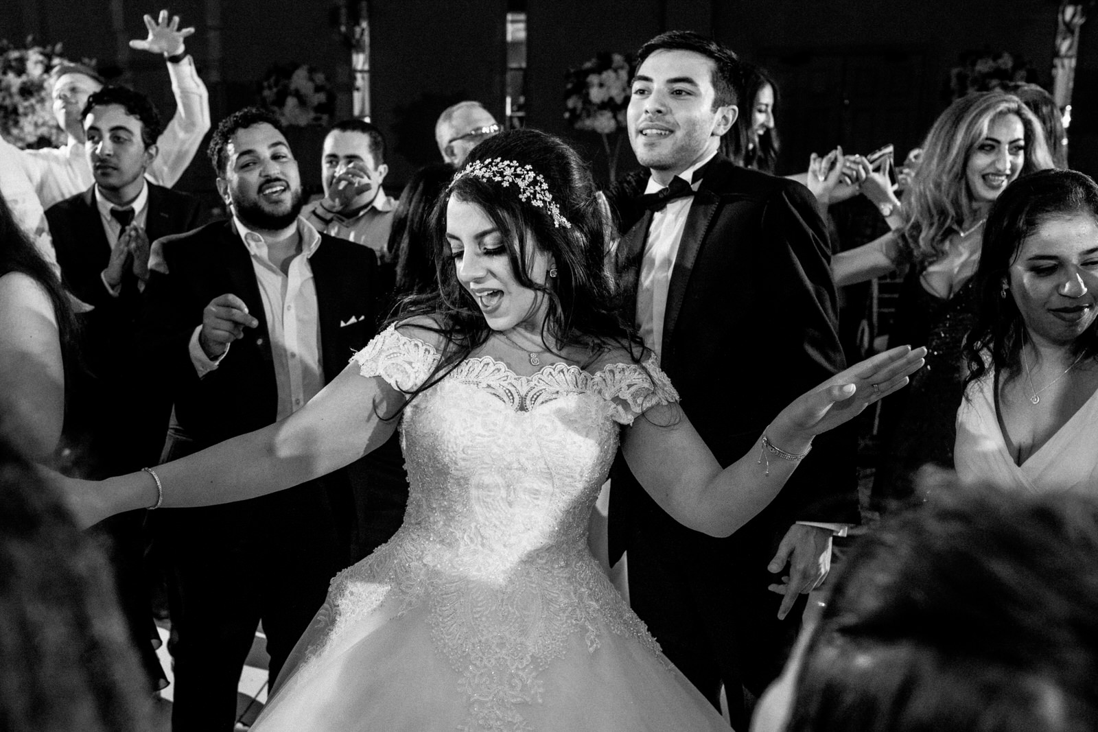 bride dancing with guests around her