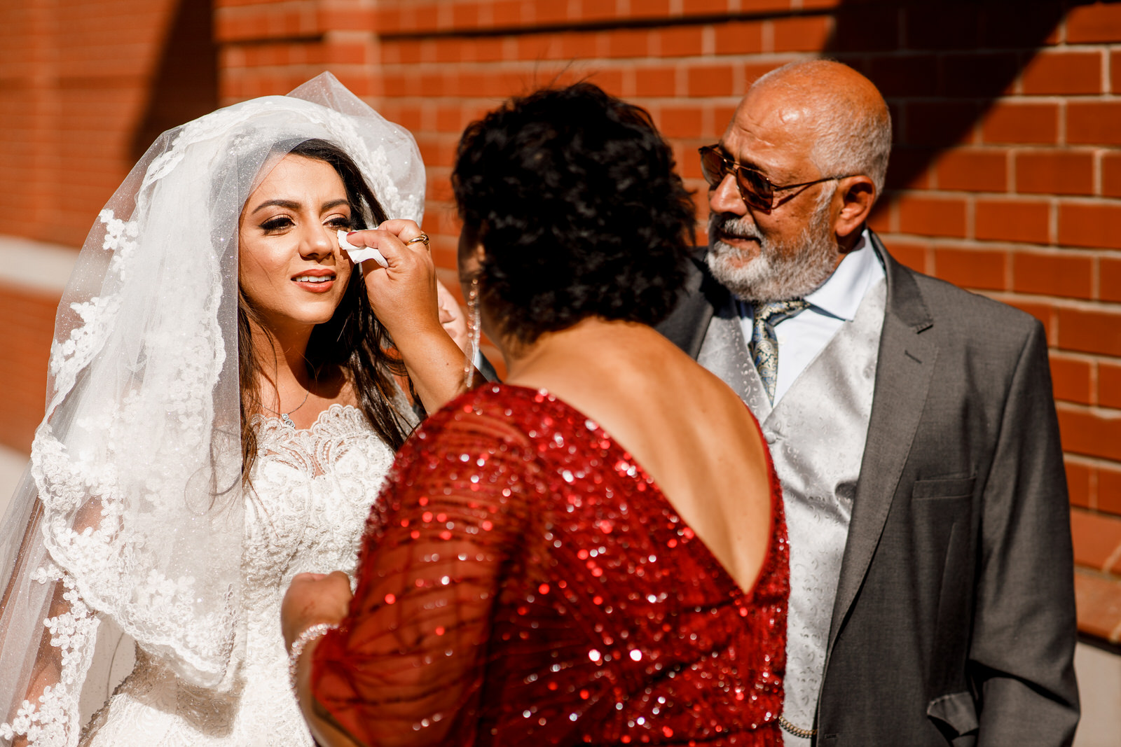 mother wiping brides eye