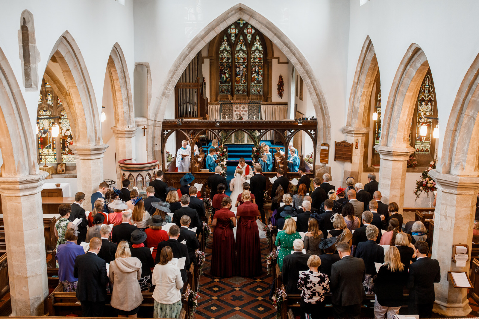 aerial shot of church in henley with bride and groom at altar
