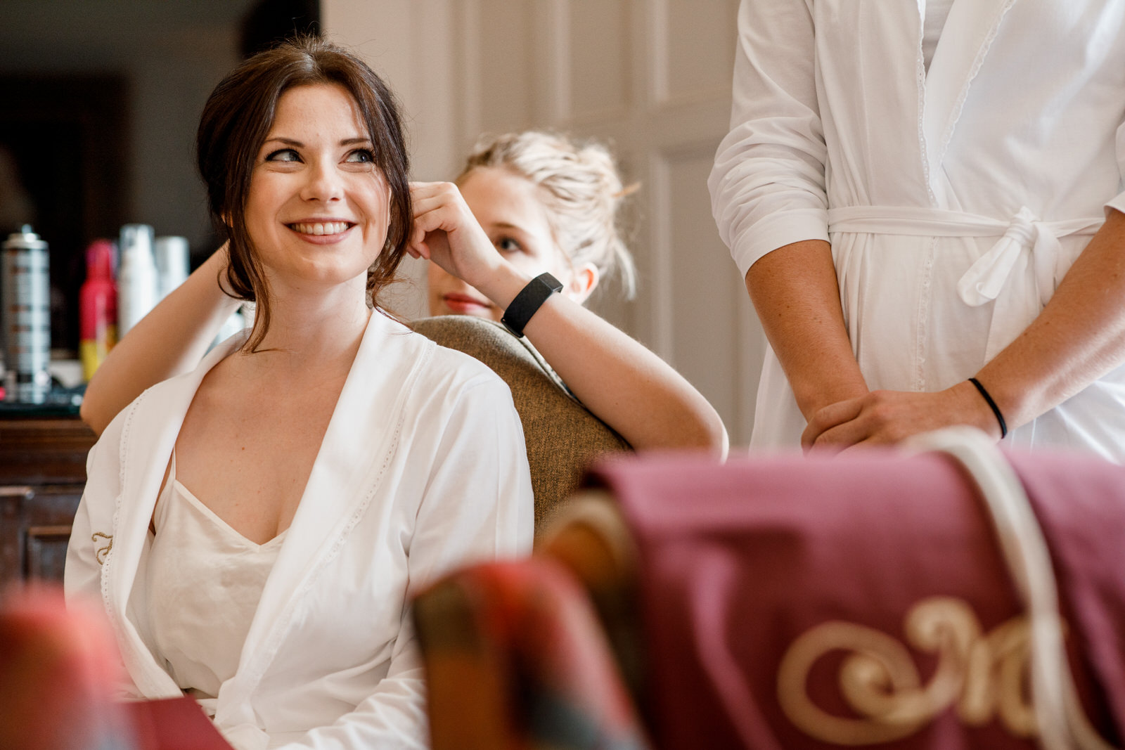 bridesmaid getting ready at danesfield house
