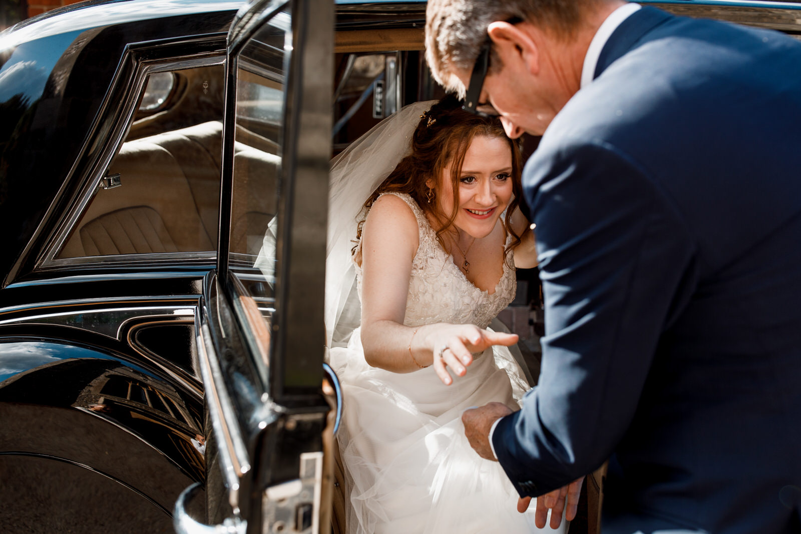 bride getting out of wedding car at hedsor house