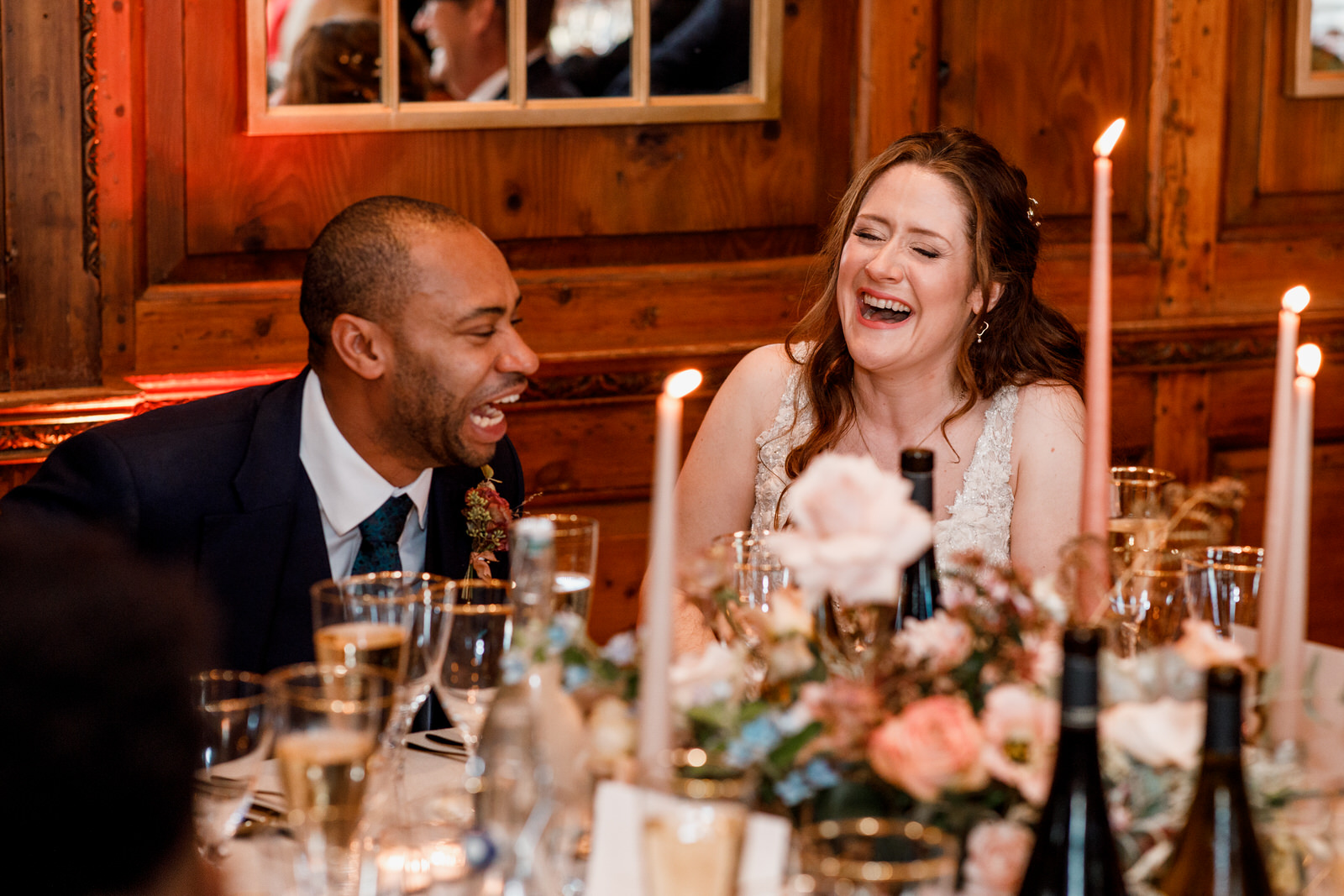 bride and groom laughing at speeches at winter wedding in hedsor house