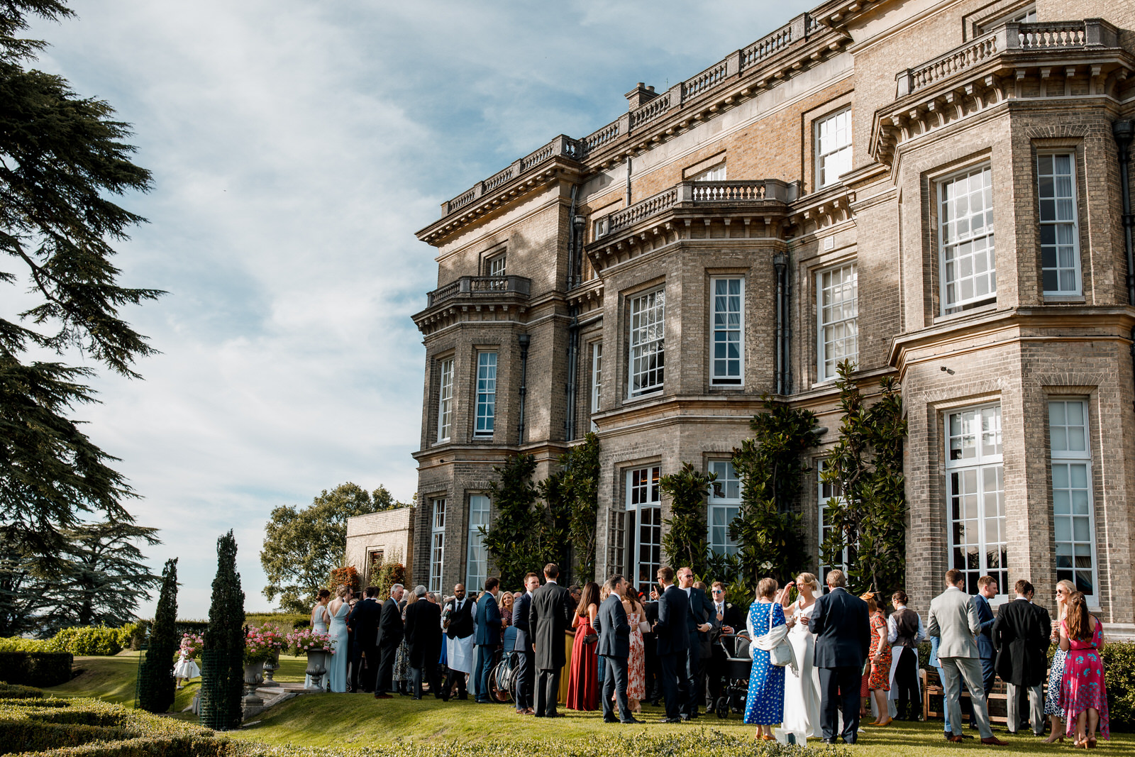 wedding guests in garden at hedsor house