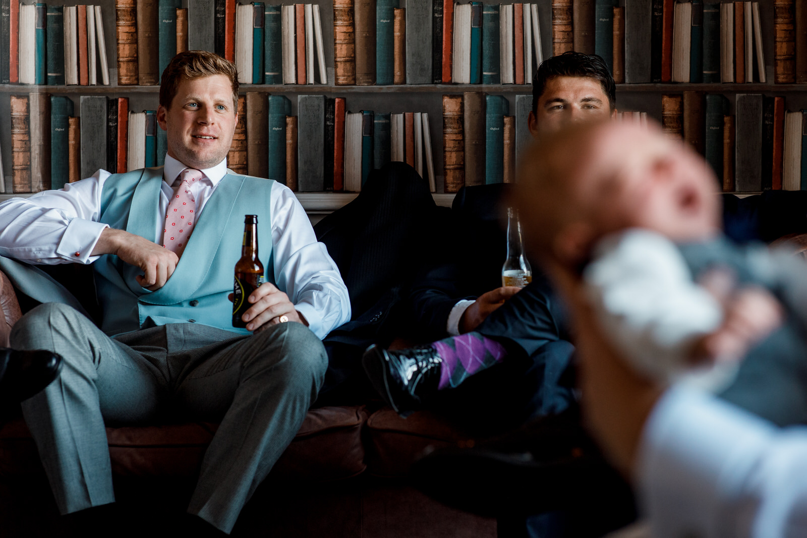 groom relaxing with beer before wedding