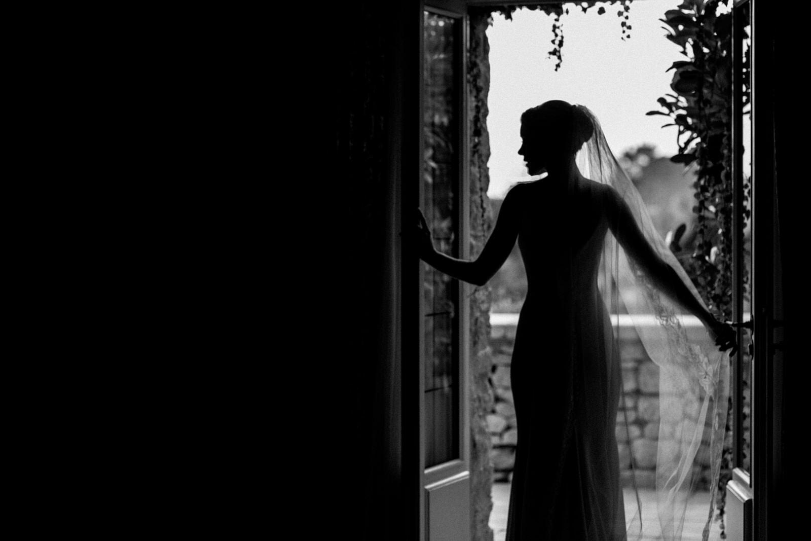 silhouette of bride in doorway