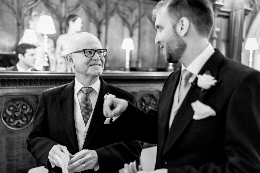 father and son at chichester catherdral on wedding day