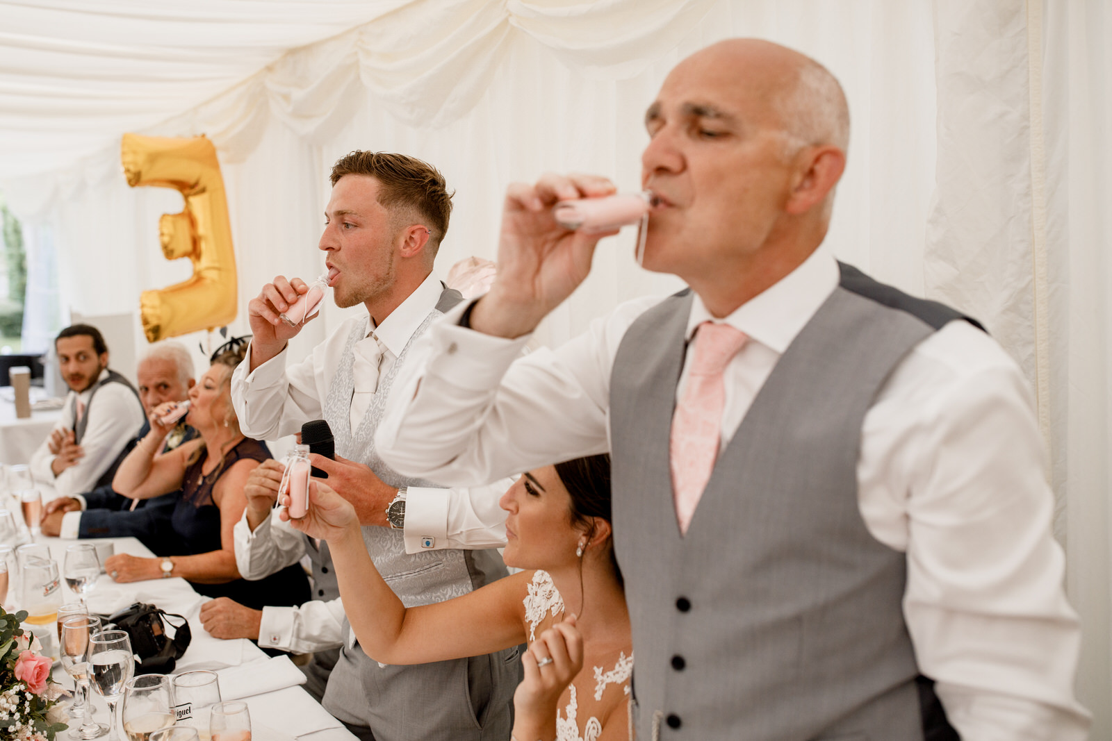 groom downing a shot