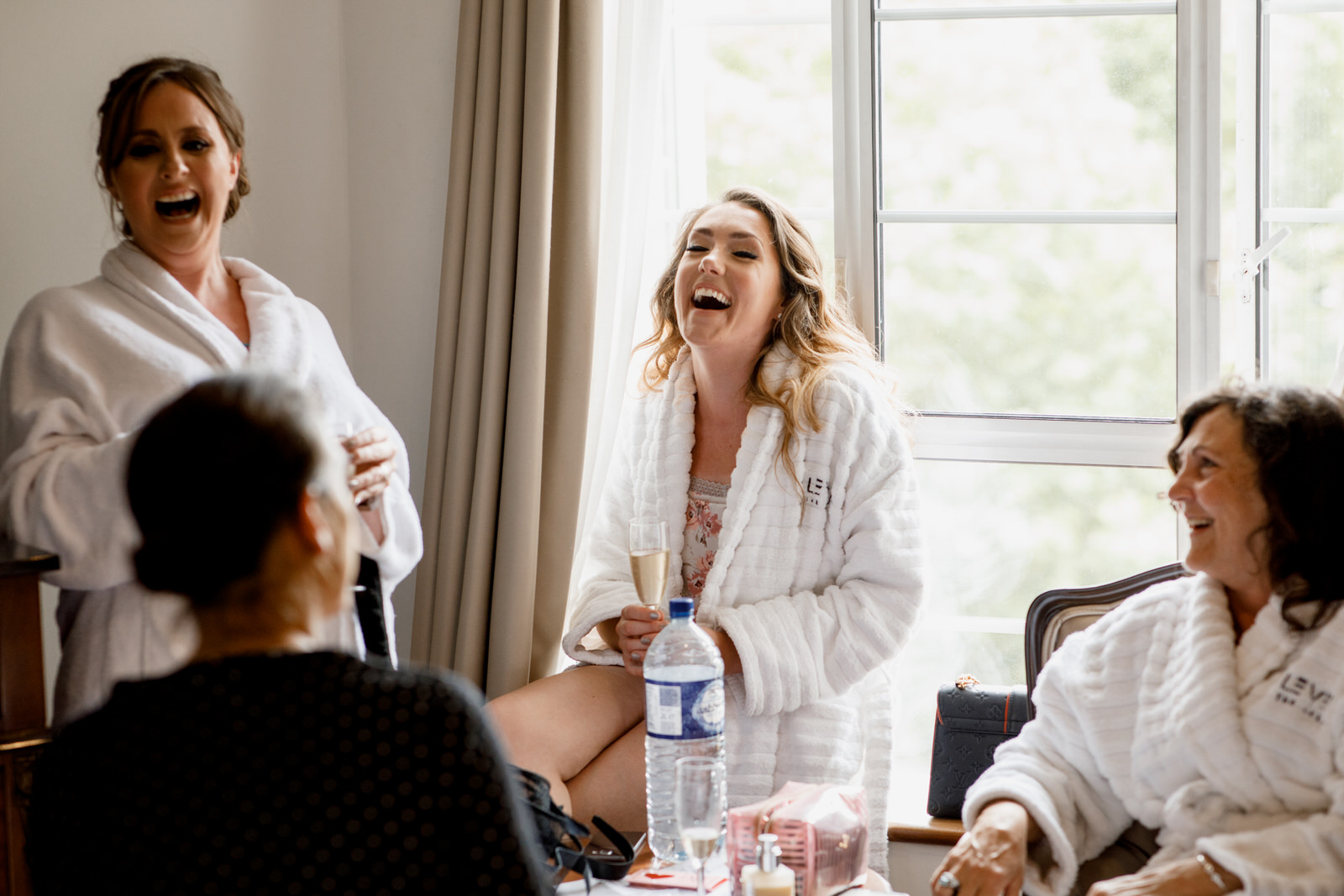 bridesmaid laughing at wedding in window