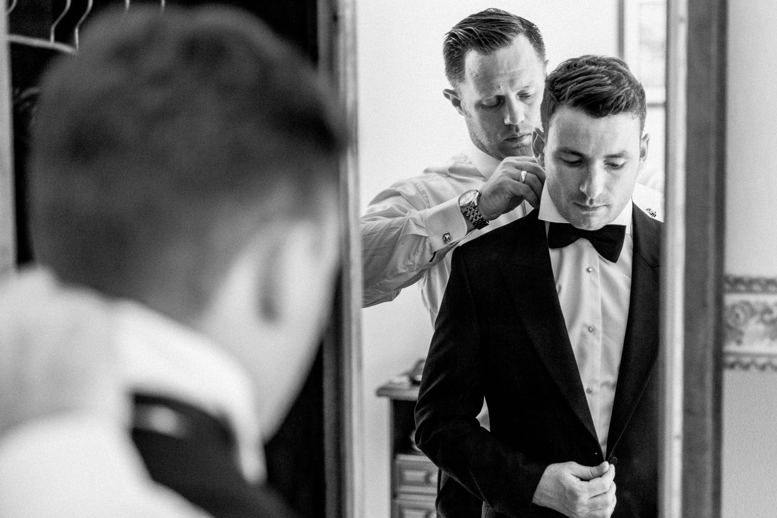 groom getting ready for lake como wedding