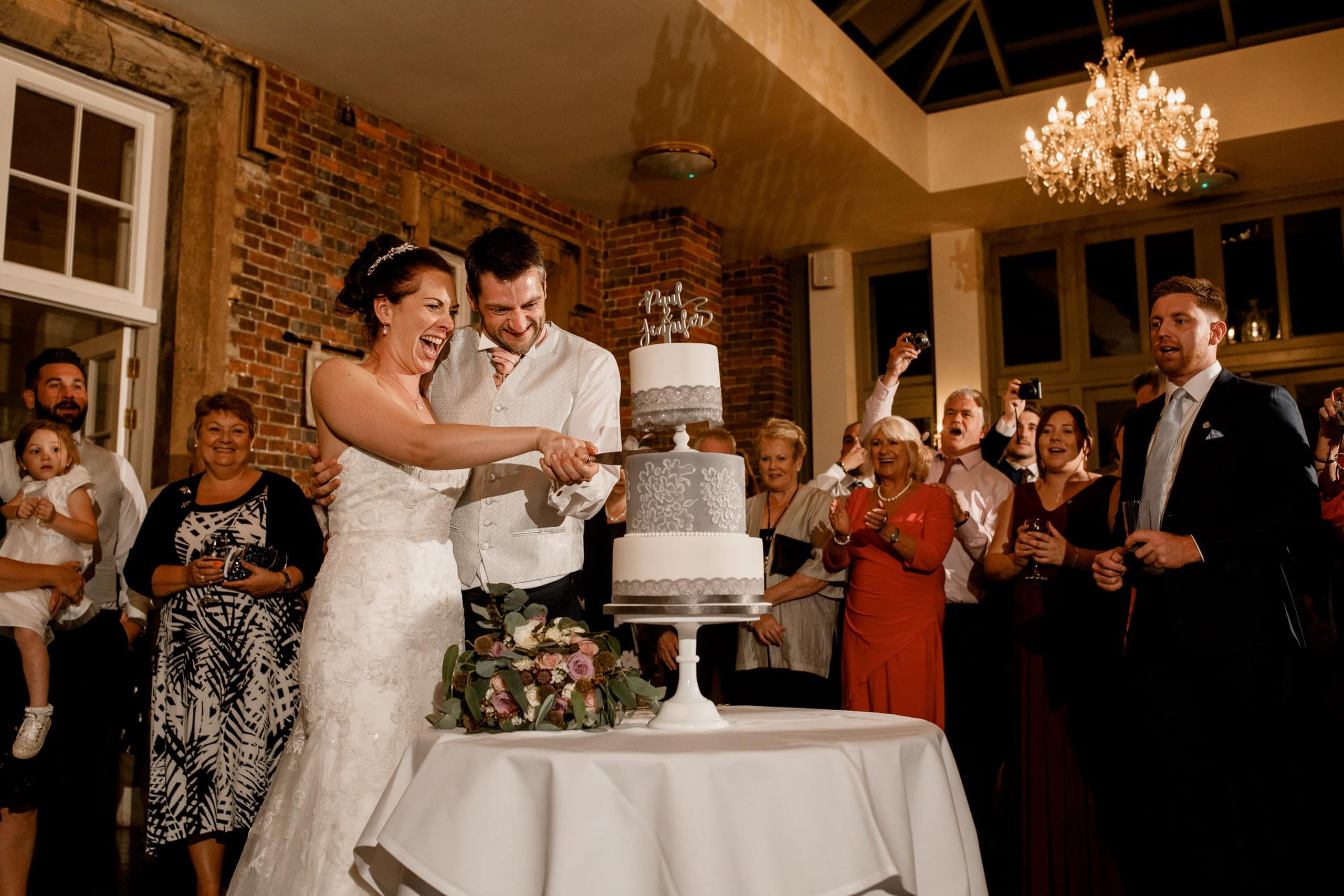 cutting cake at offley place wedding