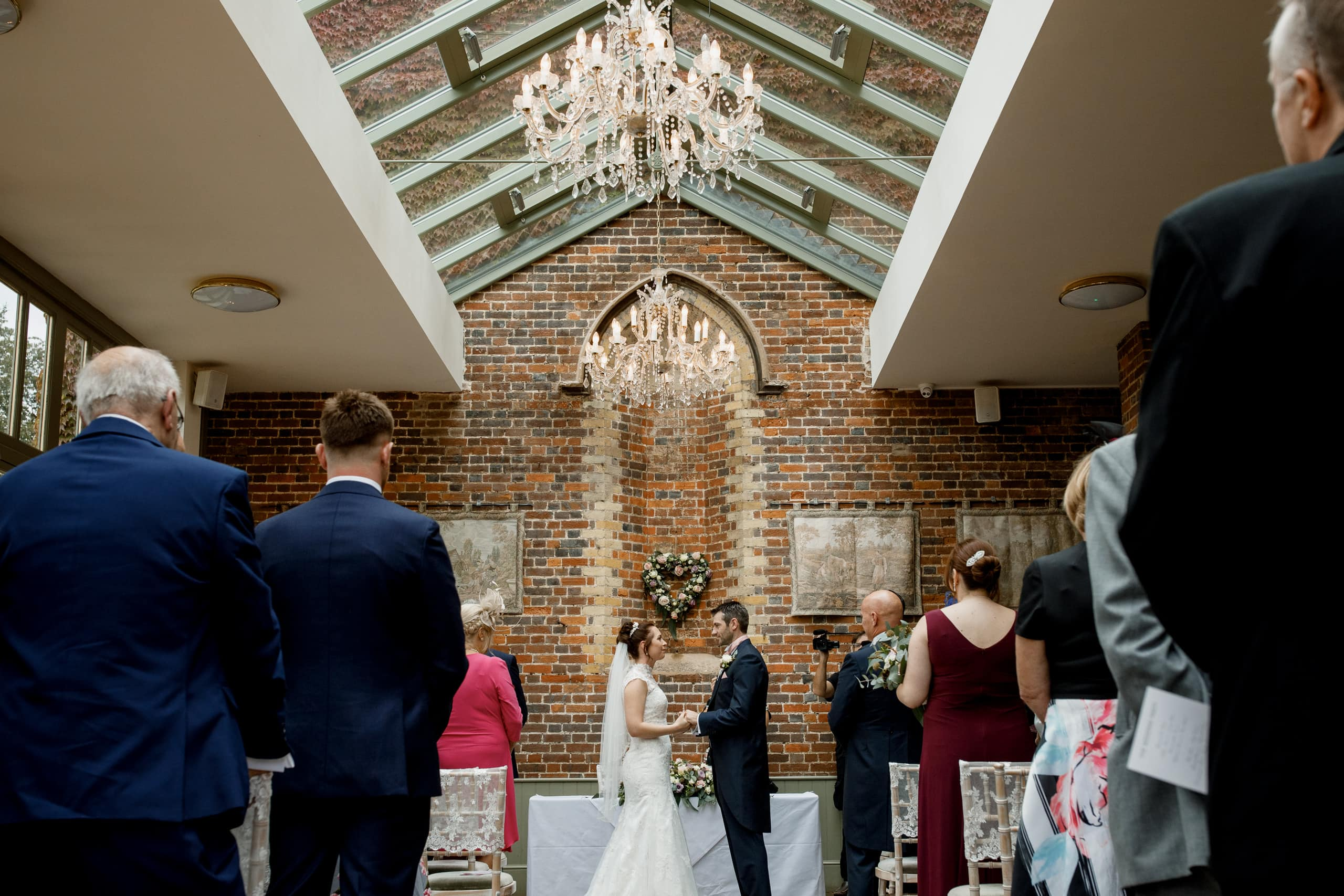 bride and groom in conservatory at offley place