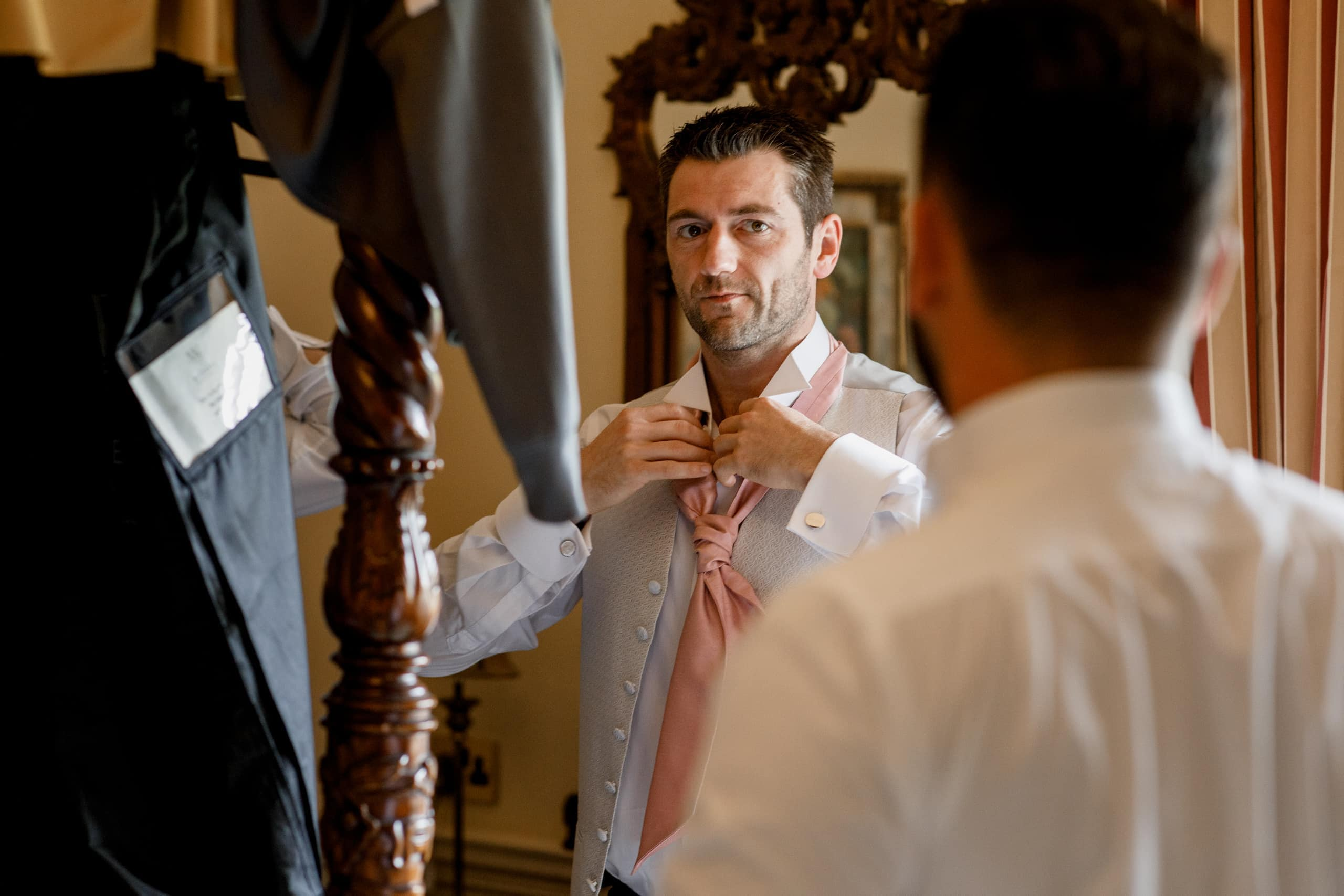 groom doing tie at offley place