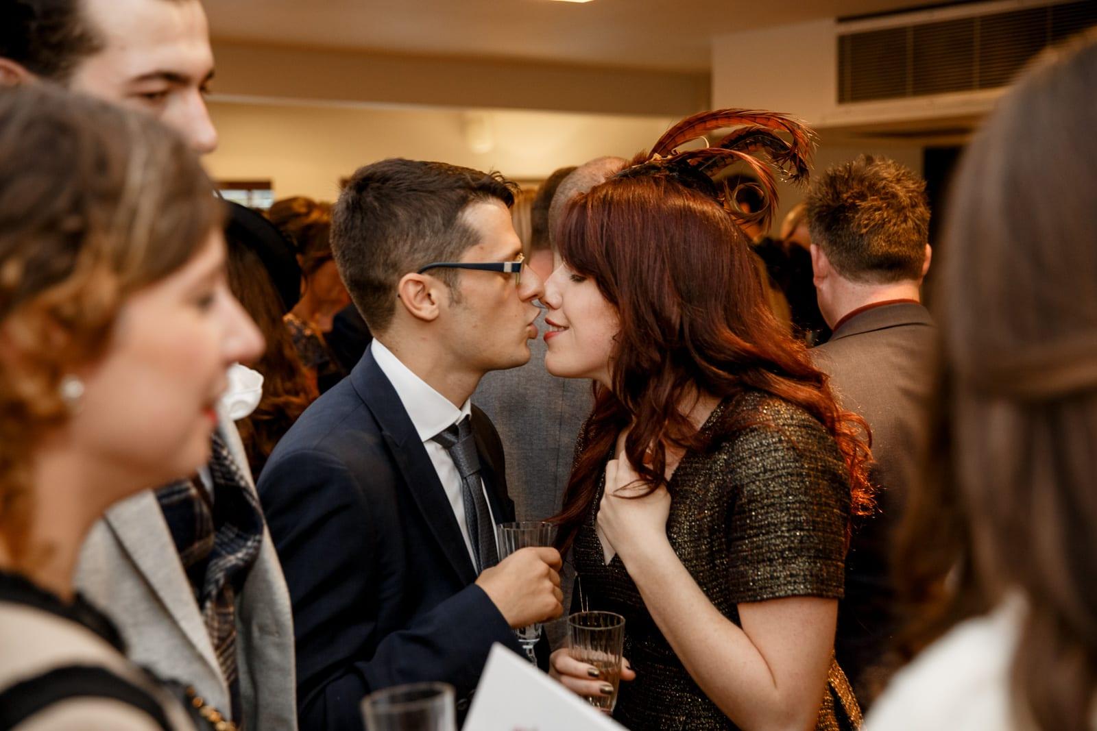 guests kissing at wedding