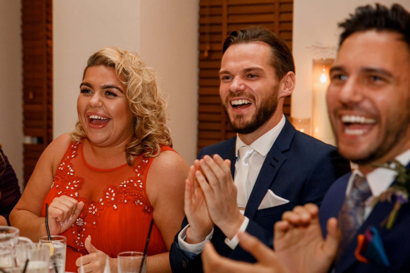 guests laughing at wedding speeches