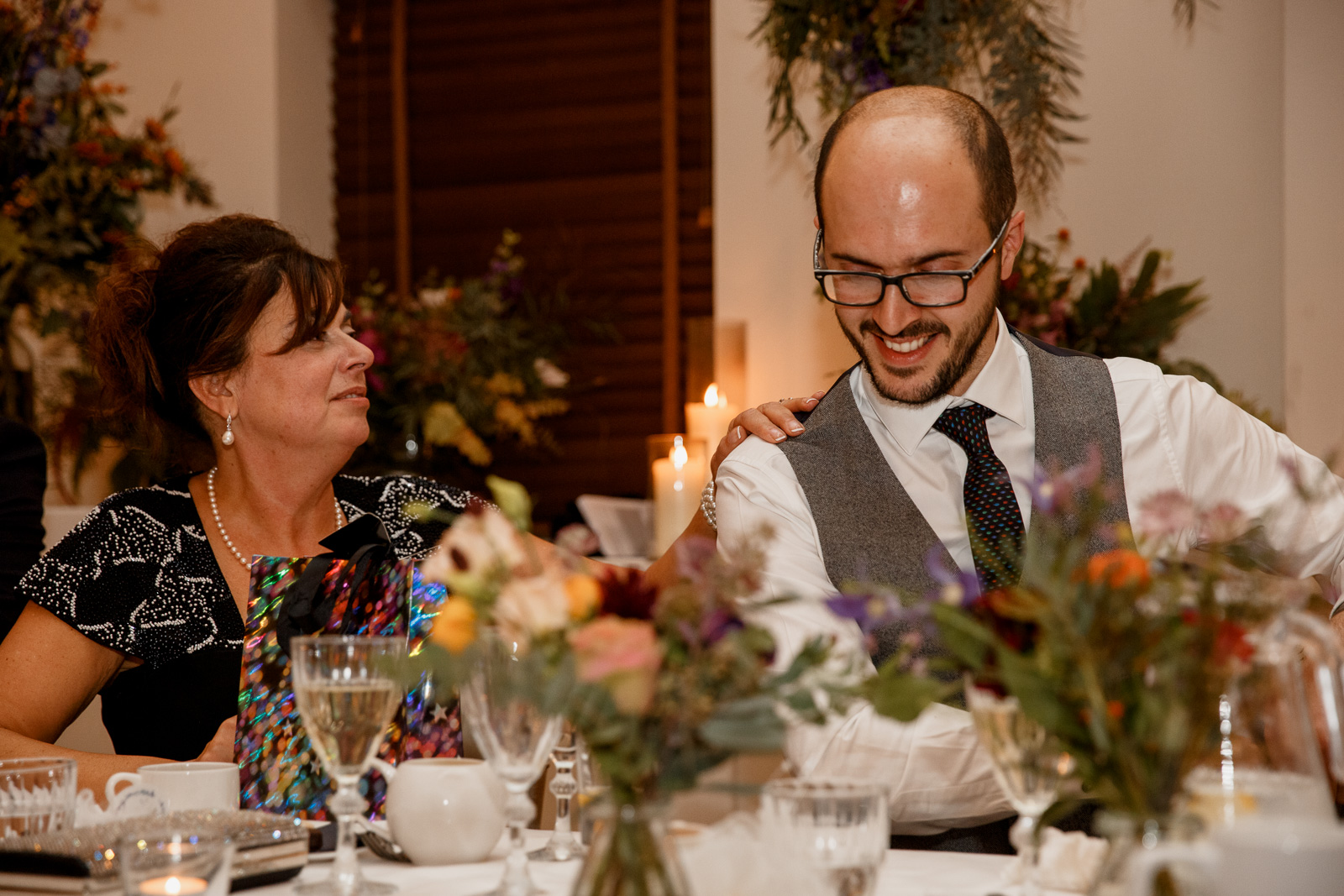 groom laughing with mother