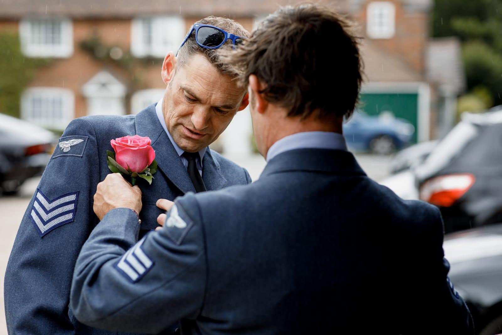 groom pinning flower