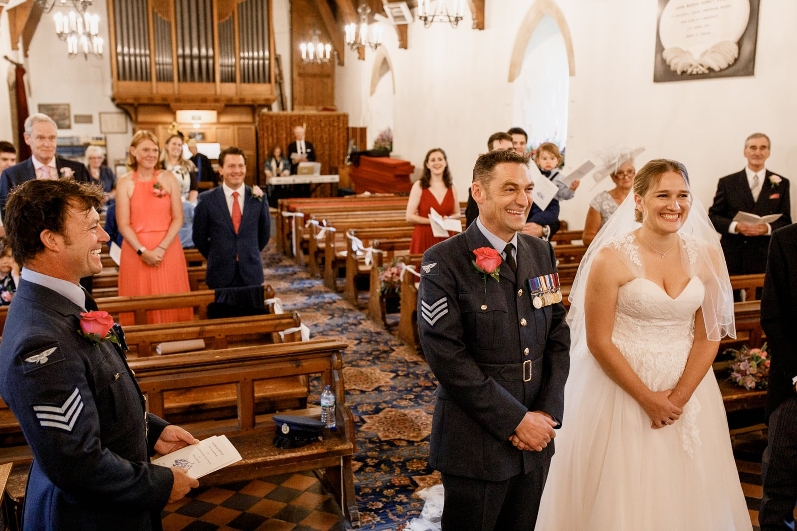 military bride and groom at altar